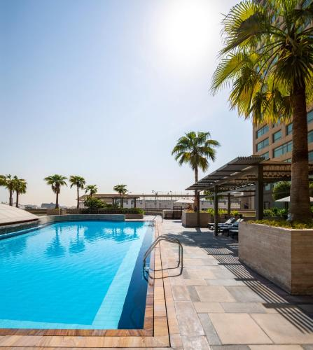 The swimming pool at or near Swissôtel Al Ghurair Dubai