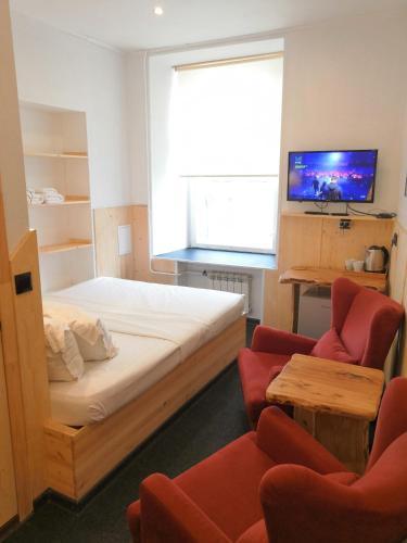 Кровать или кровати в номере Wood Design Hotel