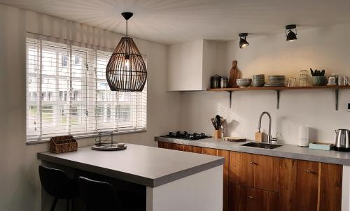 A kitchen or kitchenette at INTIKA Beach House