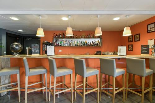 The lounge or bar area at Appart'City Confort Le Bourget - Aéroport