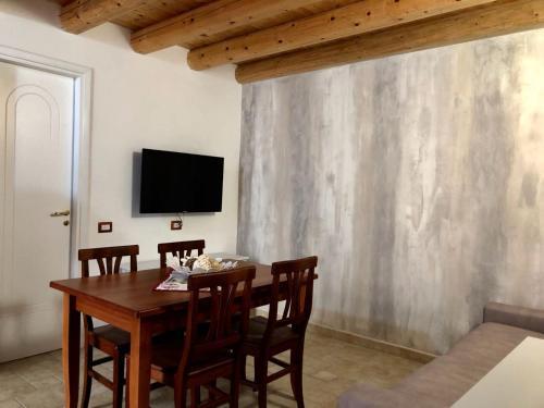 A television and/or entertainment center at casa vacanza grazia