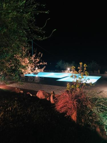 The swimming pool at or near Agriturismo La Rocca Manna