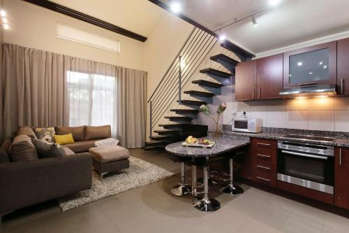 Area tempat duduk di Absolute Farenden Apartments