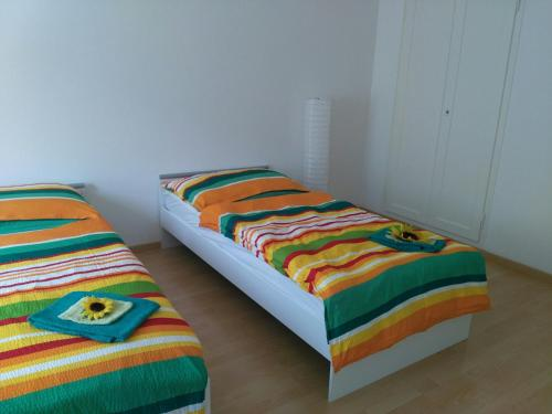 A bed or beds in a room at Calm Family Apartment
