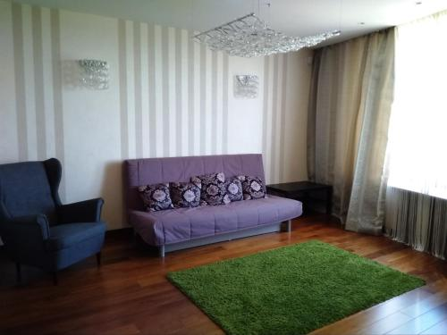 A seating area at Apartment near Petergof