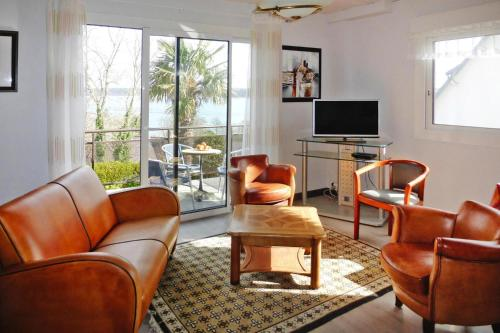 A seating area at Holiday Home Perros-Guirec - BRE02690-F