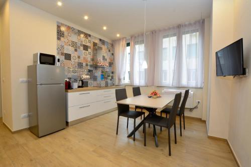 A kitchen or kitchenette at La Dotta apartments