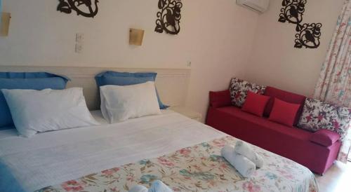 Ένα ή περισσότερα κρεβάτια σε δωμάτιο στο Villa Nefeli