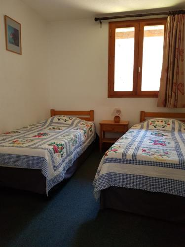 A bed or beds in a room at Saint-Roch Piste