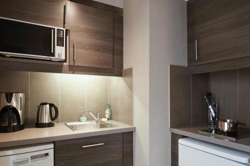 A kitchen or kitchenette at Aparthotel Adagio Marseille Vieux Port