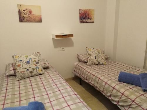 A bed or beds in a room at Playa Fuengirola