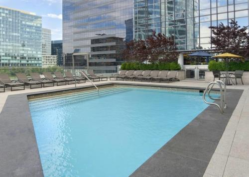 The swimming pool at or near Global Luxury Suites at Boston Seaport