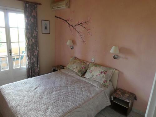 Ένα ή περισσότερα κρεβάτια σε δωμάτιο στο Villa Georgia