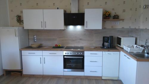 A kitchen or kitchenette at Landhaus Palle