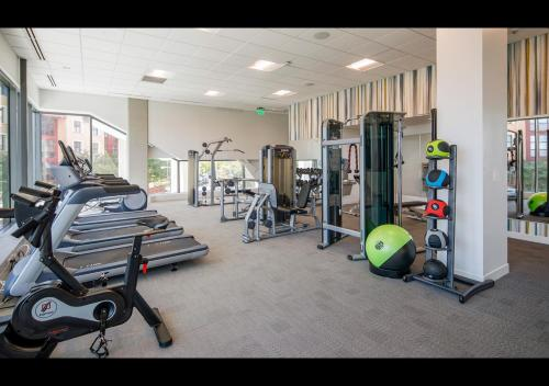 The fitness center and/or fitness facilities at Kenshō Homes at University City