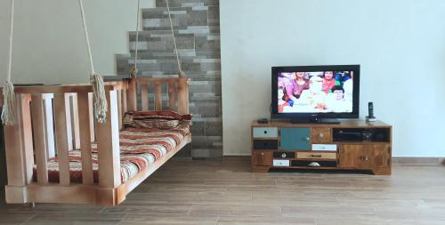 A television and/or entertainment center at Batusi Apartment