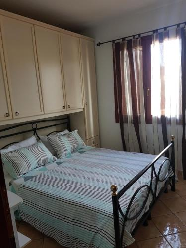A bed or beds in a room at Casa Mirabelle