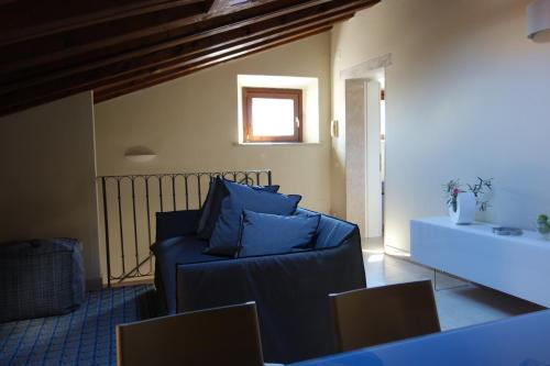 A seating area at Corte San Luca Apartments