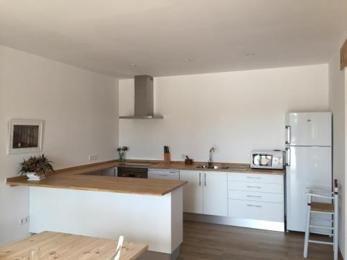 A kitchen or kitchenette at Son busqueret