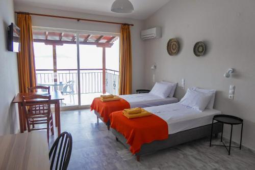Ένα ή περισσότερα κρεβάτια σε δωμάτιο στο Αφροδίτη