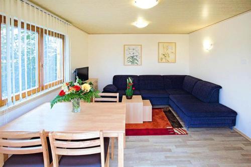 A seating area at Holiday resort Erzeberg Bad Emstal - DMG011005-FYB
