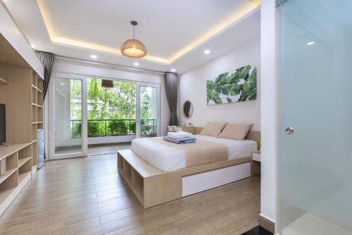 Кровать или кровати в номере Cozrum Homes - Yoga Corner
