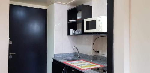 A kitchen or kitchenette at Apartamento Exclusivo Center