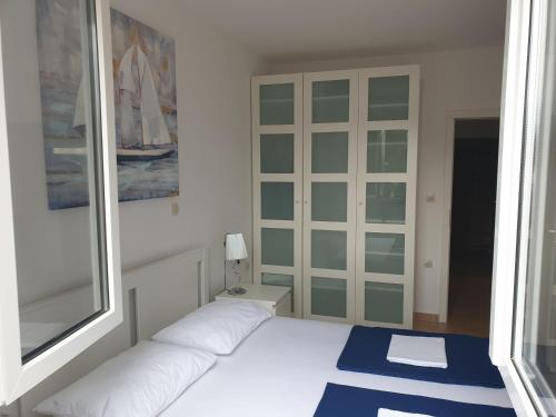 A bed or beds in a room at Apartments Melior