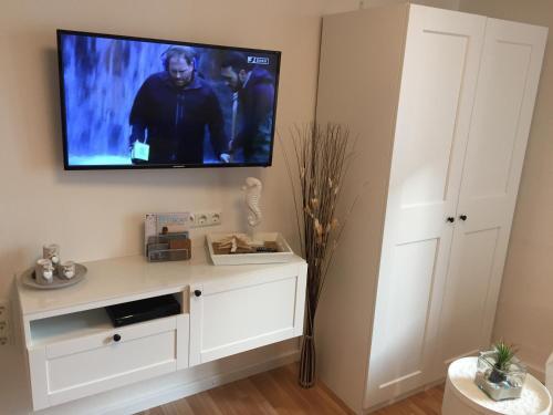 TV/Unterhaltungsangebot in der Unterkunft Haus Solymar App. Meerblick