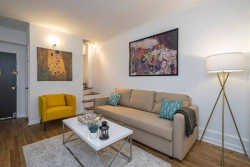 A seating area at CITY CENTER!!! - GORGEOUS Apartment with Deck