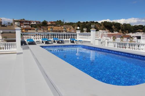 The swimming pool at or near Apartamentos Las Americas