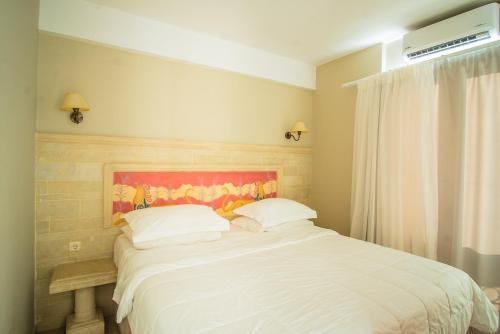 A bed or beds in a room at Parthenis Beach, Suites by the Sea