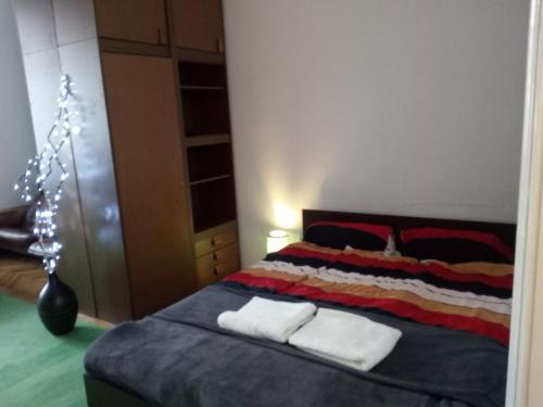 A bed or beds in a room at Master apartment