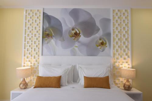 Ein Bett oder Betten in einem Zimmer der Unterkunft Lx Flowers Apartments