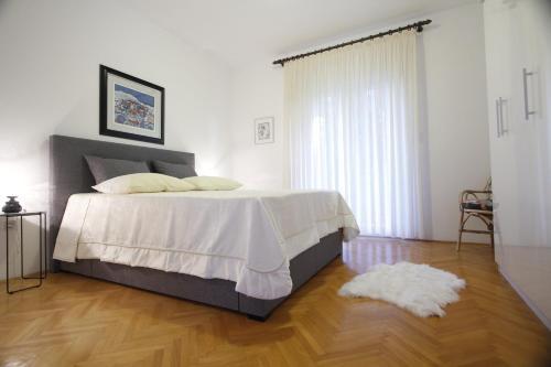 Krevet ili kreveti u jedinici u objektu Apartment Petrcane