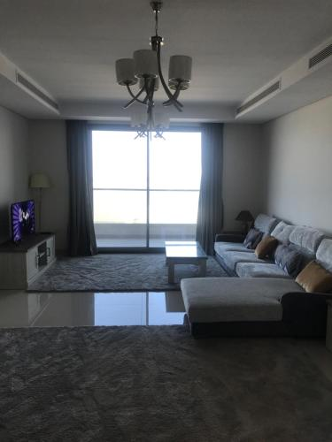 A seating area at Brand New Durrat Marina Yachet Club flat / weekend / weekdays/ weekly or monthly