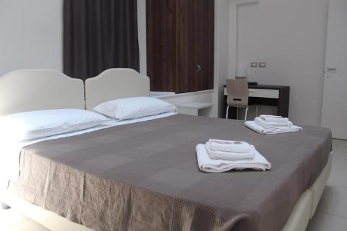 A bed or beds in a room at Time Out ApartHotel