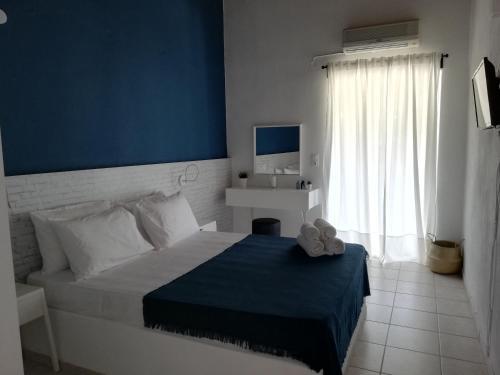 Ένα ή περισσότερα κρεβάτια σε δωμάτιο στο Rigas Rooms