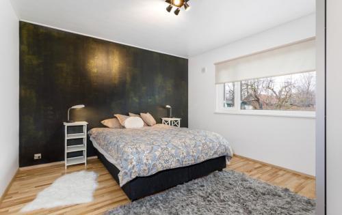 Voodi või voodid majutusasutuse NELGI 14 toas
