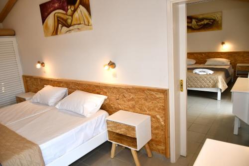 Lova arba lovos apgyvendinimo įstaigoje Cavos Beach House