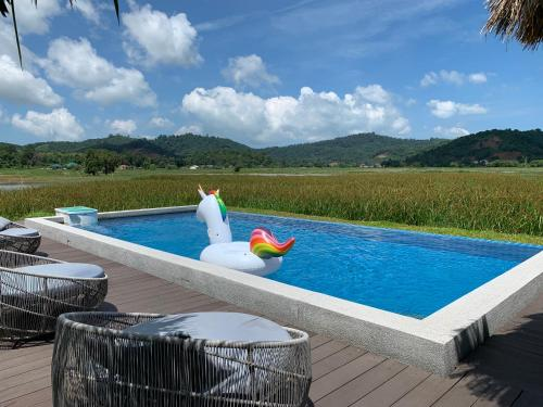 The swimming pool at or near Cloud9 Holiday Cottages