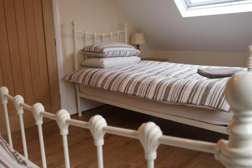 A bed or beds in a room at Murton Grange