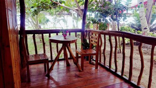 A balcony or terrace at White Beach Front and Cottages