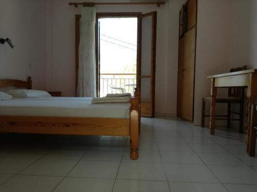 Ένα ή περισσότερα κρεβάτια σε δωμάτιο στο Mario Rooms