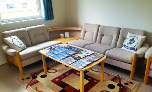 A seating area at Nord Fish Apartments