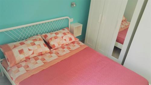Postelja oz. postelje v sobi nastanitve Aloha House Ortigia