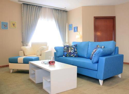A seating area at Alocassia Serviced Apartments
