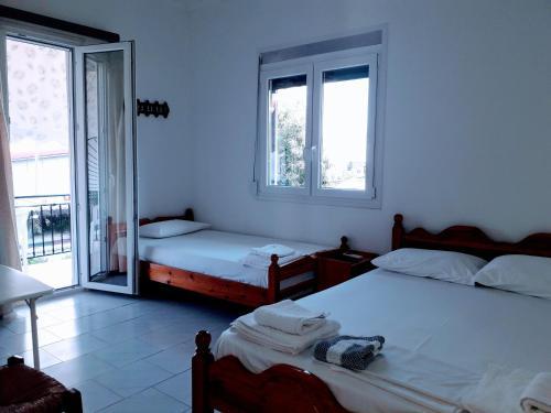 Ένα ή περισσότερα κρεβάτια σε δωμάτιο στο Giannis Studios