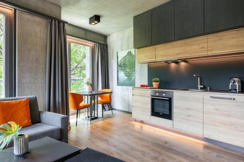 A kitchen or kitchenette at Downtown Apartments