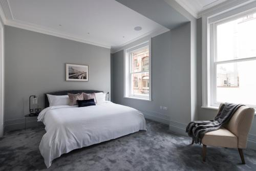 A bed or beds in a room at Sonder — Museum House